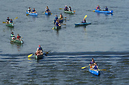 Minisink Ford, New York - A flotilla of canoes heads down the Delaware River as seen from the Roebling Bridge on July 24, 2014. ©Tom Bushey / The Image Works
