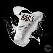 Bulldog branded moisturiser skincare for men product photography. Shot with the contents splashing around product.