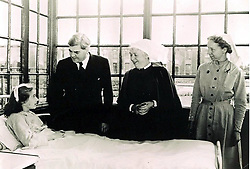 """Handout file photo dated 05/07/48, issued by the Trafford Healthcare NHS Trust, of Aneurin Bevan talking to the NHS' first patient Sylvia Diggory, 13, at Trafford General, Manchester, (formerly the Park Hospital), the NHS's """"first"""" hospital, which he also opened."""