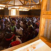Dadaab's Gambela community, refugees from Ethiopia, gather to worship on a Sunday. North Eastern Province, Kenya.