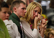 A mourner wipes a tear away at the community memorial vigil at Ben Lomond High School in Ogden for Emilie Parker, one of the children murdered during the recent school shooting at Sandy Hook Elementary, Thursday, Dec. 20, 2012
