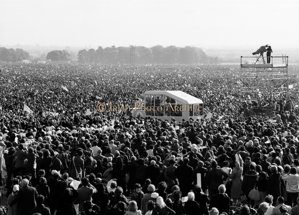 The Pope (centre of pic) makes his way on the 'Popemobile' through the vast crowds assembled in the Phoenix Park. It is estimated that well over 1 million people gathered in the Park to see the Pope. From Dublin he travelled to Drogheda and on the 30th he addressed 285,000 people at a youth rally in Galway, before travelling to Knock, County Mayo. He said Mass to another huge crowd in Limerick, before departing through Shannon airport. <br /> 29/09/1979