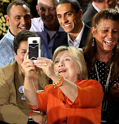 Democratic presidential nominee Hillary Clinton takes a selfie with supporters during a rally at the Osceola Heritage Park Exhibition Hall on Monday, Aug. 8, 2016 in Kissimmee, Fla. Earlier in the day, Clinton campaigned in St. Petersburg, FL, USA. Photo by Joe Burbank/Orlando Sentinel/TNS/ABACAPRESS.COM