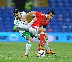 Adam Matthews of Wales is challenged by Conor McLaughlin of Northern Ireland - Mandatory by-line: Dougie Allward/JMP - Mobile: 07966 386802 - 24/03/2016 - FOOTBALL - Cardiff City Stadium - Cardiff, Wales - Wales v Northern Ireland - Vauxhall International Friendly
