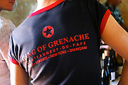 """A wine taster with a black t-shirt tshirt saying """"The Gang of Grenache"""" advertising a group of Chateauneuf-du-Pape growers. Rhone. France Europe."""