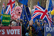As Prime Minister Theresa May tours European capitals hoping to persuade foreign leaders to accept a new Brexit deal following her cancellation of a Parliamentary vote, pro-EU Remainers protest with satirical figures opposite the Houses of Parliament, on 11th December 2018, in London, England. The figures depict L-R David Davies, Michael Gove, Boris Johnson and Theresa May.