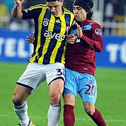 Fenerbahce's Mehmet Topuz (L) and Trabzonspor's Gustavo Colman (R) during their Turkish superleague soccer derby match Fenerbahce between Trabzonspor at the Sukru Saracaoglu stadium in Istanbul Turkey on Sunday 18 December 2011. Photo by TURKPIX