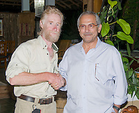 President Jose Ramos-Horta (right) welcomes British herpetologist Mark O'Shea to Timor-Leste (East Timor) at his home in Dili on February 4, 2010.