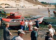 CS00388-05. moving Dory boats at Cape Kiwanda, August 1958