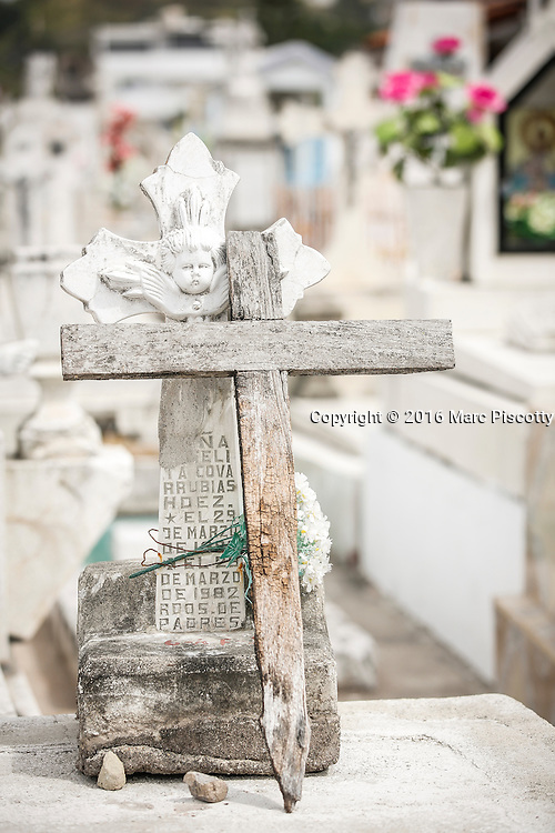 SHOT 2/8/16 12:31:29 PM - Headstones and burial sites in  the El Panteon cemetery in Puerto Vallarta, Mexico. El Panteón Cementario, also know as Cementario Viejo, is a large local cemetery in the heart of old Puerto Vallarta. Puerto Vallarta is a Mexican beach resort city situated on the Pacific Ocean's Bahía de Banderas. Tourism in Puerto Vallarta has increased steadily over the years and makes up for 50% of the city's economic activity. The high season for international tourism in Puerto Vallarta extends from late November through March and the city is a popular LGBT destination. (Photo by Marc Piscotty / © 2016)
