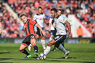 AFC Bournemouth Midfielder, Jack Wilshere (32) and Tottenham Hotspur Midfielder, Moussa Dembele (19) challenge for the ball during the Premier League match between Bournemouth and Tottenham Hotspur at the Vitality Stadium, Bournemouth, England on 22 October 2016. Photo by Adam Rivers.