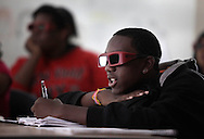 Kaseem Carruthers watches a 3D presentation on an electronic whiteboard during a biology class at Middletown High School on Thursday, May 13, 2010.