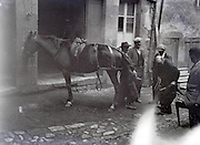 blacksmith at work fitting a horse shoe 1930s
