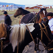 Gauchos saddle horses at rustic, but luxurious lodge in the shadow of the towers themselves.