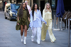 The members of Little Mix, (left to right) Leigh-Anne Pinnock, Jade Thirlwall and Perrie Edwards, arriving at the studios of Global Radio in London. Picture date: Friday April 30, 2021.