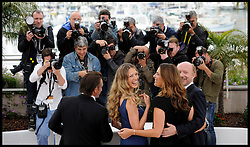Petra Nemcova and Sean Penn pose for photographers with other cast members as they attend the Photocall for Haiti Carnival in  Cannes, France, Friday 18th May 2012. Photo by Andrew Parsons/i-Images.