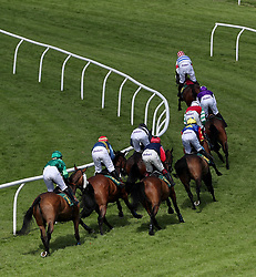 The field takes the bend in the Tracy Williams 50th Birthday Celebration Handicap Hurdle at Bangor-on-Dee Racecourse.