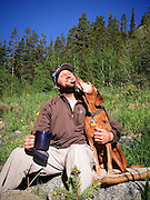 SHOT 6/22/15 11:26:44 PM - Camping in the Cottonwood Pass area with Meredith Hogan and Tanner. Marc Piscotty gets a kiss from his dog, Tanner, as the two share coffee and some morning sun together while camping. (Photo by Marc Piscotty / © 2015)