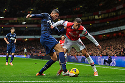 Arsenal Defender Kieran Gibbs (ENG) is challenged by Man Utd Defender Chris Smalling (ENG) - Photo mandatory by-line: Rogan Thomson/JMP - 07966 386802 - 12/02/14 - SPORT - FOOTBALL - Emirates Stadium, London - Arsenal v Manchester United - Barclays Premier League.