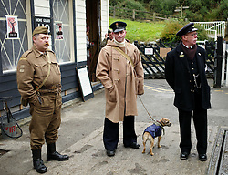 © Licensed to London News Pictures. <br /> 16/10/2016. <br /> Goathland, UK.  <br /> <br /> Enthusiasts dressed in 1940's military clothing wait for the train at Goathland station during the final day of the North Yorkshire Moors Railway Wartime Weekend event. <br /> The annual event brings together re-enactors and enthusiasts along the length of the NYMR heritage steam railway line to recreate the feel of the war years of the 1940's. <br /> <br /> Photo credit: Ian Forsyth/LNP