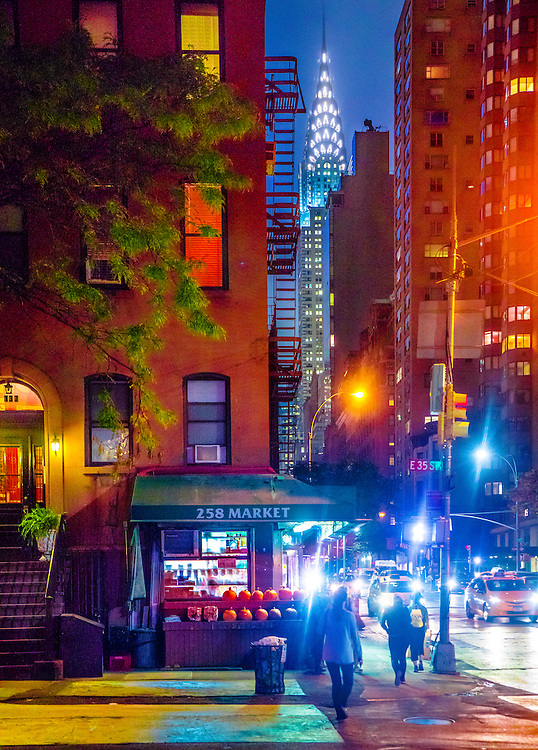 Manhattan's Murray Hill nighborhood with the glowing Art Deco-style Chrysler Building in the background