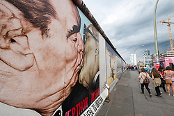 mural of The Kiss painted on original section of Berlin Wall at East Side gallery in Berlin, Germany ...Editorial Use Only