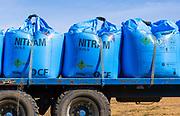 Bags of blue Nitram nitrogen fertiliser on back of lorry trailer, Suffolk, England, UK