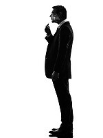 one caucasian business man smoking electronic e-cigarette in silhouette on white background