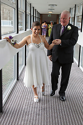 Bride who has cerebral palsy, with grandfather at wedding ceremony.