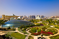 View from the balcony of a hotel room in the Raffles Dubai Hotel over the Raffles Botanical Garden and the Wafi City Mall (an Egyptian themed shopping mall featuring pyramid shaped domes), Dubai, United Arab Emirates
