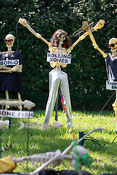 30 October 2015. New Orleans, Louisiana.<br /> The Skeleton Krewe mansion on St Charles Avenue at the corner of State Street draws crowds with its satirically spooky Halloween decorations. Mick Jagger of the 'Rolling Bones.'<br /> Photo©; Charlie Varley/varleypix.com