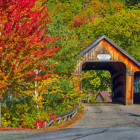 The iconic Ashland Covered Bridge in Ashland, New Hampshire framed by New England fall foliage.<br />