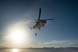 Rescue helicopter training on ship in Spitsbergen, Svalbard, Norway