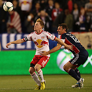 Dax McCarty, (left), New York Red Bulls, is challenged by Andy Dorman, New England Revolution, during the New York Red Bulls V New England Revolution, Major League Soccer regular season match at Red Bull Arena, Harrison, New Jersey. USA. 20th April 2013. Photo Tim Clayton