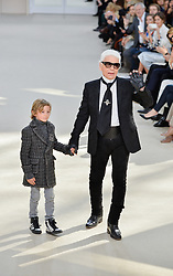 File photo - Karl Lagerfeld and his nephew Hudson Kroenig pose on the runway during the Chanel show as part of the Paris Fashion Week Womenswear Fall/Winter 2016/2017 at Grand Palais in Paris, France on March 8, 2016. Karl Lagerfeld died on Monday at age 85. One who may inherit is his godson Hudson. Hudson's dad, model Brad Kroenig, is like 'family' to Lagerfeld. Hudson began modeling for Chanel at age two and had continued to pop up on the runway ever since. Photo by ABACAPRESS.COM