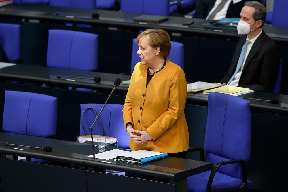 24 MAR 2021, BERLIN/GERMANY:<br /> Angela Merkel, CDU, Bundeskanzlerin, waehrend der Regierungsbefragung durch den Bundestag zur Bekaempfung der Corvid-19 Pandemie, Plenarsaal, Reichstagsgebaeude, Deutscher Bundestag<br /> IMAGE: 20210324-01-016<br /> KEYWORDS: Corona