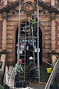 Workmen begin erecting scaffolding to the front of the Grade II listed public Carnegie Library in Herne Hill, closed by Lambeth council in 2016 to partially-convert it into a gym - something locals and library users say they dont want or need, on 15th November 2017, in London, England.