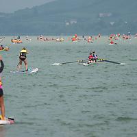 Participants paddle their boats across Lake Balaton near Fonyod, Hungary on Aug. 16, 2020. ATTILA VOLGYI