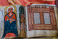 """700 year old book, from the 13th century, is a """"living book"""" as it is still used in services,  Cave Monastery Neakuto Leab, near Lalibela, Ethiopia."""