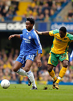 Photo: Leigh Quinnell.<br /> Chelsea v Norwich City. The FA Cup. 17/02/2007.<br /> Chelseas Mikel keeps the ball from Norwichs'  Dickson Etuhu.