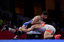 JAKARTA, Aug. 19, 2018  Hassan Yazdanicharati (Top)of Iran competes during Men's Wrestling Freestyle 86 kg Final against Domenic Michael Abounader of Lebanon at the 18th Asian Games at Jakarta, Indonesia, Aug. 19, 2018. (Credit Image: © Yue Yuewei/Xinhua via ZUMA Wire)