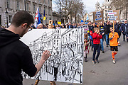 An artist painting at the Put It To The People march for a Peoples Vote on 23rd March 2019 in London, United Kingdom. With less than one week until the UK is supposed to be leaving the European Union, the final result still hangs in the balance and protesters gathered in their hundreds of thousands to make political leaders take notice and to give the British public a vote on the final Brexit deal.