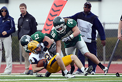 12 November 2011:  AJ Hoger gets stopped by P.J. Cummings and Ryan Gresko during an NCAA division 3 football game between the Augustana Vikings and the Illinois Wesleyan Titans in Tucci Stadium on Wilder Field, Bloomington IL