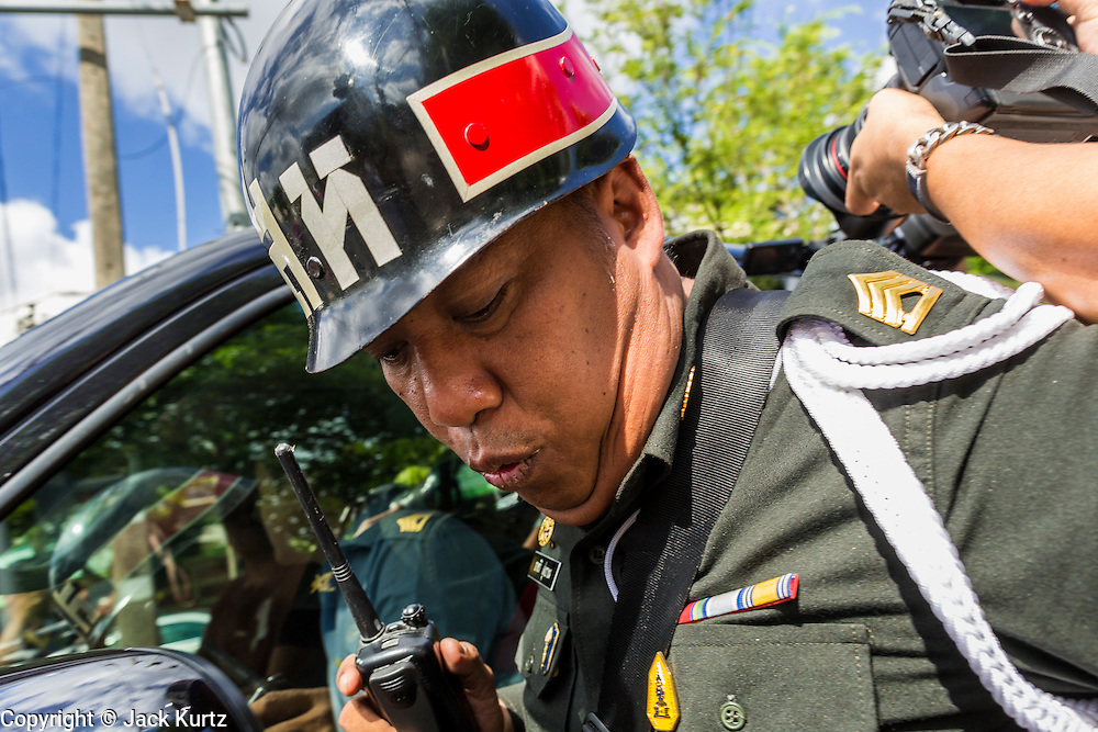 23 MAY 2014 - BANGKOK, THAILAND: A Thai army military policeman tries to control the media at a checkpoint where Thai politicians were supposed to surrender to authorities in Bangkok. The Thai military seized power in a coup Thursday evening. They suspended the constitution and ended civilian rule. This is the 2nd coup in Thailand since 2006 and at least the 12th since 1932. The army has ordered both anti-government protestors in Bangkok and pro-government protestors in the suburbs to go home and arrested leaders of both groups.    PHOTO BY JACK KURTZ