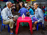 "24 NOVEMBER 2017 - YANGON, MYANMAR: Muslim men in Yangon have tea at a tea stand after Friday midday prayers. Many Muslims in overwhelmingly Buddhist Myanmar feel their religion is threatened by a series of laws that target non-Buddhists. Under the so called ""Race and Religion Protection Laws,"" people aren't allowed to convert from Buddhism to another religion without permission from authorities, Buddhist women aren't allowed to marry non-Buddhist men without permission from the community and polygamy is outlawed. Pope Francis is to arrive in Myanmar next week and is expected to address the persecution of the Rohingya, a Muslim ethnic minority in western Myanmar. Some Muslims and Christians are concerned that if the Pope's comments take too strong of pro-Rohingya stance, he could exacerbate religious tensions in the country.  PHOTO BY JACK KURTZ"