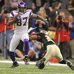 Jan 24, 2010; New Orleans, LA, USA; Minnesota Vikings wide receiver Bernard Berrian (87) runs past New Orleans Saints cornerback Tracy Porter (22) during a 31-28 overtime victory by the New Orleans Saints over the Minnesota Vikings in the 2010 NFC Championship game at the Louisiana Superdome. Mandatory Credit: Derick E. Hingle-US PRESSWIRE