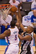 June 2, 2012; Oklahoma City, OK, USA; Oklahoma City Thunder forward Serge Ibaka (9) attempts to block a shot by San Antonio Spurs center Boris Diaw (33) during a playoff game  at Chesapeake Energy Arena.  Thunder defeated the Spurs 109-103 Mandatory Credit: Beth Hall-US PRESSWIRE