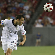 USA defender Steve Cherundolo (6) heads the ball during a CONCACAF Gold Cup soccer match between the United States and Panama on Saturday, June 11, 2011, at Raymond James Stadium in Tampa, Fla. (AP Photo/Alex Menendez)