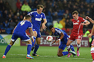 Craig Noone of Cardiff city ® is tackled by Tyrone Mings of Ipswich .Skybet football league championship match, Cardiff city v Ipswich Town at the Cardiff city stadium in Cardiff, South Wales on Tuesday 21st October 2014<br /> pic by Andrew Orchard, Andrew Orchard sports photography.