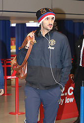 Marouane Fellaini of Manchester United is spotted on his way to catch a flight as the team fly to Turin on Tuesday afternoon to play Juventus in The Champions League on Wednesday night.